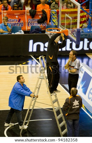 VALENCIA, SPAIN - JANUARY 28: Several operators repairing the basket during the ACB league match between Valencia Basket  and Asefa Estudiantes, 85-71, on January 28, 2012, in Valencia, Spain - stock photo