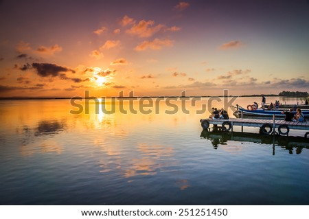 VALENCIA, SPAIN - JULY 14: Group of tourist in Albufera on July 14, 2014 in Valencia, Spain The Albufera is a freshwater lagoon and estuary on the Gulf of Valencia coast of the Valencian Community. - stock photo