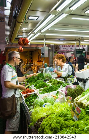 VALENCIA, SPAIN - JULY 14: Shopping in the Colon market. The building was opened on Christmas 1916 on July 14, 2014 in Valencia, Spain.