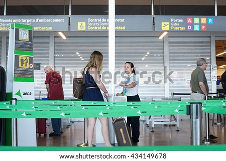 VALENCIA, SPAIN - JUNE 9, 2016: Airline passengers checking in at the security line at the Valencia Airport. About 4.98 million passengers passed through the airport in 2015. - stock photo