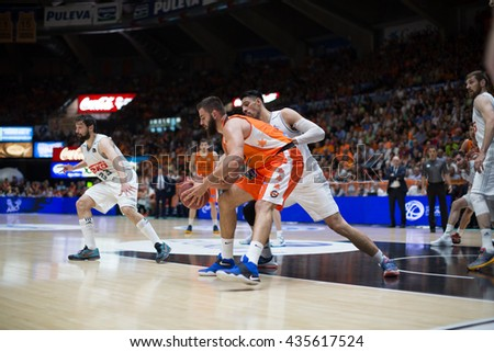 VALENCIA, SPAIN - JUNE 9th: Dubljevic with ball and Ayon during 4th playoff match between Valencia Basket and Real Madrid at Fonteta Stadium on June 9, 2016 in Valencia, Spain - stock photo