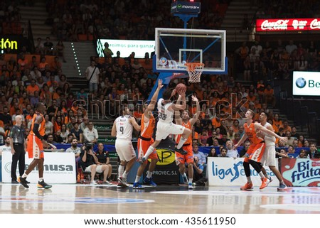 VALENCIA, SPAIN - JUNE 9th: Llull with ball during 4th playoff match between Valencia Basket and Real Madrid at Fonteta Stadium on June 9, 2016 in Valencia, Spain - stock photo