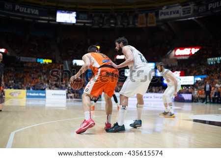 VALENCIA, SPAIN - JUNE 9th: San Emeterio with ball and Llull during 4th playoff match between Valencia Basket and Real Madrid at Fonteta Stadium on June 9, 2016 in Valencia, Spain - stock photo