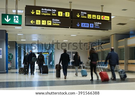 VALENCIA, SPAIN - MARCH 14, 2016: Airline passengers inside the Valencia Airport. About 4.59 million passengers passed through the airport in 2014. - stock photo