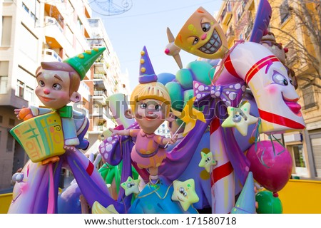 VALENCIA, SPAIN - MARCH 2013: Fallas of Valencia is a popular fest with humor figures on streets that will burn in March 19 night, Valencia, Spain March 2013 - stock photo