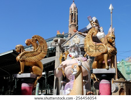 VALENCIA, SPAIN - MARCH 16, 2014: Fallas or Falles Monuments created to celebrate St. Joseph, on March 16, 2014 in Valencia, Spain. It's a popular Festival of fire, satire, music and firecrackers. - stock photo