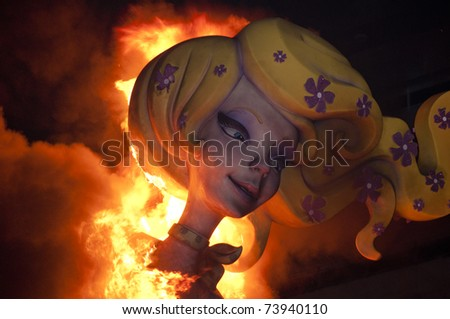 VALENCIA, SPAIN - MARCH 19: Las Fallas, where huge papermache models are constructed then burnt, a traditional celebration for Saint Joseph on March 19, 2011 in Valencia, Spain.