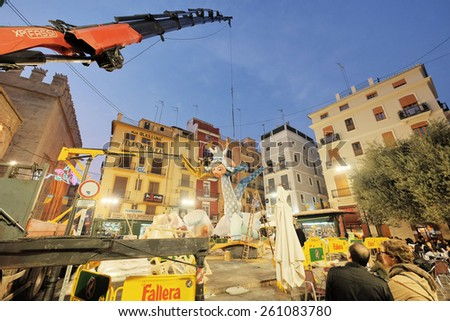 """Valencia, Spain - March 13, 2015: Mounting the """"falla"""" from the Dr. Collado Square in Valencia, Spain. """"Fallas"""" from Valencia are the traditional valencian festivities in honor to St. Joseph. - stock photo"""