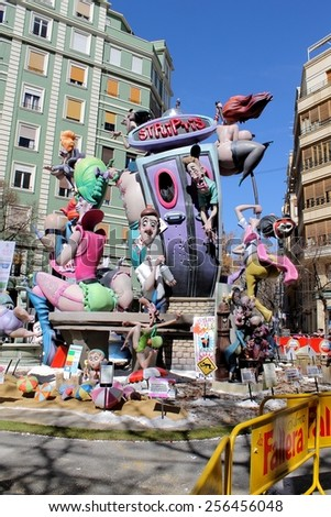 VALENCIA, SPAIN - MARCH 16, 2014: Striptease Fallas or Falles Monuments created to celebrate St. Joseph, on March 16, 2014 in Valencia, Spain. Popular Festival of fire, satire, music and firecrackers. - stock photo