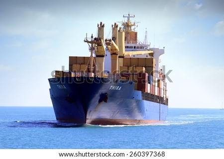 """VALENCIA, SPAIN   MARCH  07: The container ship """"THIRA"""" is sailing prepared to enter in the port of Valencia, on march 07, 2015 in Valencia. - stock photo"""