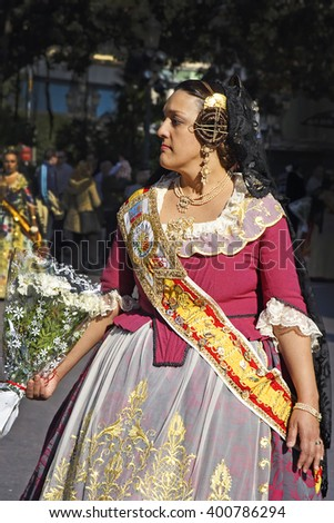 VALENCIA, SPAIN - MARCH 17, 2007: Unknown woman on Fallas celebration, this is one of the biggest festivals in Spain where people dresses traditionally, celebration for Saint Joseph in Valencia - stock photo