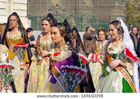 VALENCIA, SPAIN - MARCH 17, 2007: Unknown women, Fallas celebration, one of the biggest parties in Spain where people dresses traditionally, celebration for Saint Joseph on March 17, 2007 in Valencia, Spain - stock photo