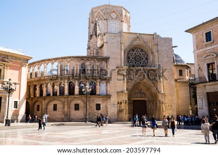 VALENCIA, SPAIN - MARCH 30: Virgin square with the Basilica of the Desamparados Virgin on March 30, 2013 in Valencia, Spain. It was built between 1652 and 1666.  - stock photo