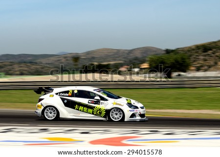 VALENCIA, SPAIN - MAY 2: Spanish driver Jordi Oriola races in a Opel Astra OPC in the TCR International Series, at Ricardo Tormo's Circuit, on May 2, 2015 in Cheste, Spain. - stock photo