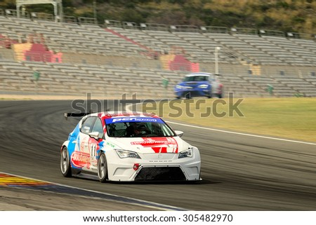 VALENCIA, SPAIN - MAY 2: Team formed by Harriet Arruabarrena and Antonio Aristi races in a Seat Leon Cup Racer in the Spanish Endurance Championship, at Ricardo Tormo's Circuit, on May 2, 2015. - stock photo