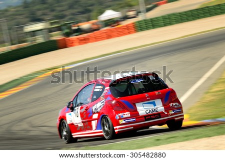 VALENCIA, SPAIN - MAY 2: Team formed by Stefano Bozzoni and David Martin Molina races in a Peugeot 207 THP in the Spanish Endurance Championship, at Ricardo Tormo's Circuit, on May 2, 2015 in Cheste. - stock photo