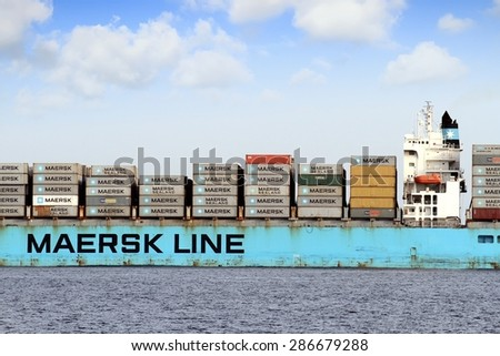 """VALENCIA, SPAIN   MAY  07: The container ship """"MAERSK KIEL"""" after leaving the port of Valencia is sailing in open waters, on may 07, 2015 in Valencia.  - stock photo"""