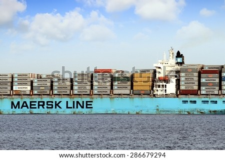 "VALENCIA, SPAIN   MAY  07: The container ship ""MAERSK KIEL"" after leaving the port of Valencia is sailing in open waters, on may 07, 2015 in Valencia.  - stock photo"