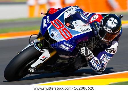 VALENCIA, SPAIN - NOV 10: Jorge Lorenzo during MotoGP Grand Prix of the Comunitat Valenciana on November 10, 2013, Valencia, Spain  - stock photo