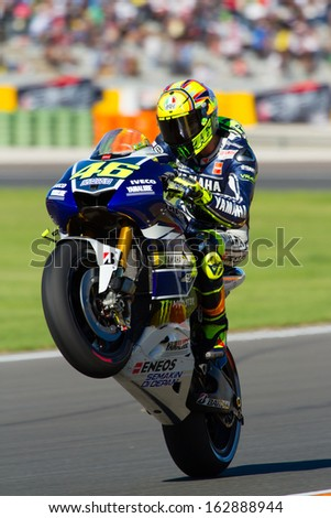 Valentino rossi stock images royalty free images vectors valencia spain nov 10 valentino rossi pulls a wheelie during motogp grand prix voltagebd Image collections