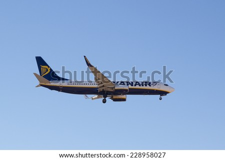 VALENCIA, SPAIN - NOVEMBER 6, 2014: A Ryanair aircraft landing at the Valencia, Spain Airport. Ryanair is the biggest low-cost airline company in the world.