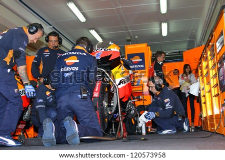 VALENCIA - SPAIN, NOVEMBER 10: Pit crew of Casey Stoner during qualifying at 2012 Generali MotoGP of Valencia on November 10, 2012 - stock photo