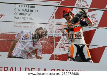 VALENCIA - SPAIN, NOVEMBER 9: Spanish Honda rider Marc Marquez wins the MotoGP race at 2014 Generali MotoGP of Valencia on November 9, 2014 - stock photo