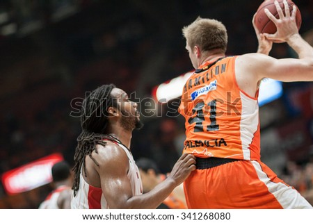 VALENCIA, SPAIN - NOVEMBER 18th: Hamilton with Ball and Falker during Eurocup between Valencia Basket Club and Sluc Nancy at Fonteta Stadium on November 18, 2015 in Valencia, Spain - stock photo