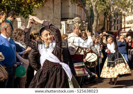 VALENCIA, SPAIN - NOVEMBER 6, 2016. Women in local costume, perform a traditional dance on Plaza del Mercado (Placa del Mercat), Valencia ,at 100 years since the founding of the central market.