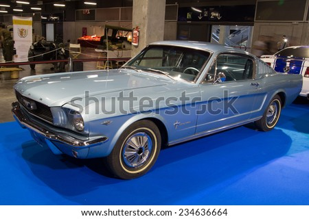 VALENCIA, SPAIN - OCTOBER 17, 2014: A blue classic Ford Mustang at the Retro Auto and Moto Valencia Classic Car Show. The Ford Mustang was introduced on April 17, 1964 at the New York World's Fair. - stock photo