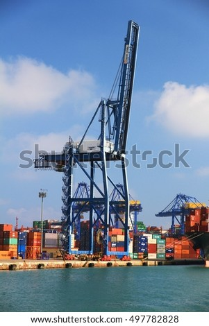 VALENCIA, SPAIN - OCTOBER 02: Containers special cranes and travelift of TCV Company for download container ship in big pier of Valencia harbor, on October 02, 2016 in Valencia.