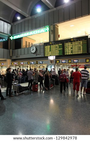VALENCIA, SPAIN - OCTOBER 10: Travelers wait at the airport on October 10, 2010 in Valencia, Spain. Valencia Airport is the 10th busiest in Spain with almost 5 million passengers in 2011. - stock photo