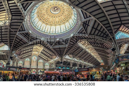 VALENCIA, SPAIN - OCTOBER 10, 2015: View of crowded Central Market interiors. It is considered one of the oldest European markets still running, most vendors sell food items. Beautiful design - stock photo