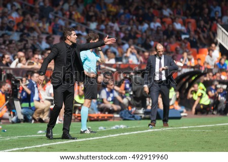 VALENCIA, SPAIN - OCTUBER 2nd: (L) Cholo Simeone during Spanish soccer league match between Valencia CF and Atletico de Madrid at Mestalla Stadium on Octuber 2, 2016 in Valencia, Spain
