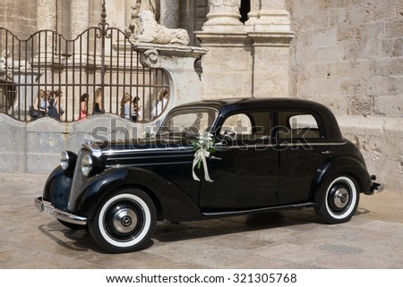 VALENCIA, SPAIN - SEPTEMBER 26, 2015: A Mercedes-Benz 170S parked in front of the Valencia Cathedral. The Mercedes-Benz 170S was a luxury four cylinder passenger car manufactured between 1949-1952. - stock photo