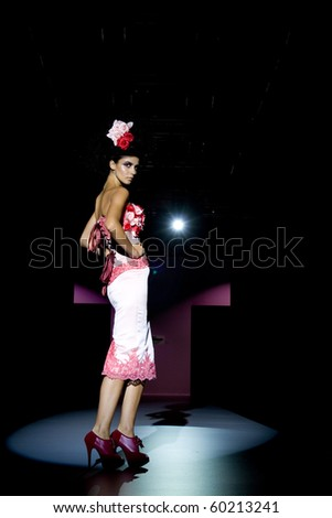 VALENCIA, SPAIN - SEPTEMBER 1: A model on the catwalk wearing a Maya Hansen design for the Valencia Fashion Week on September 1, 2010 in Valencia, Spain.