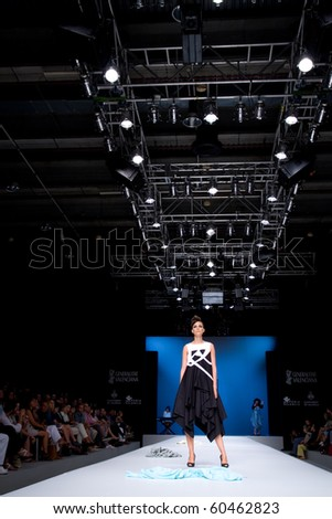 VALENCIA, SPAIN - SEPTEMBER 1: A model on the catwalk wears Tonuca design for the Valencia Fashion Week on September 1, 2010 in Valencia, Spain. - stock photo