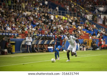 VALENCIA, SPAIN - SEPTEMBER 11: Kakuta and Morales during BBVA LEAGUE match between Levante U.D. And Sevilla C.F. at Ciudad de Valencia Stadium on September 11, 2015 in Valencia, Spain