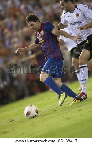VALENCIA, SPAIN - SEPTEMBER 21:Messi in the Spanish Soccer League between Valencia C.F. vs F.C. Barcelona - Mestalla Luis Casanova Stadium - Spain on September 21, 2011 - stock photo