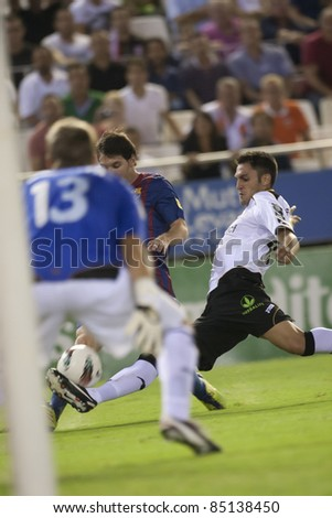 VALENCIA, SPAIN - SEPTEMBER 21 :(R) Rami, Messi and Guaita in the Spanish Soccer League between Valencia C.F. vs F.C. Barcelona - Mestalla Luis Casanova Stadium - Spain on September 21, 2011 - stock photo