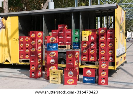 VALENCIA, SPAIN - SEPTEMBER 11, 2015:  Stacks of Amstel beer in a delivery truck. Amstel Brewery was a Dutch brewery founded in 1870 in Amsterdam and was bought by Heineken in 1968.