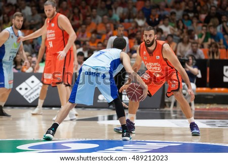 VALENCIA, SPAIN - SEPTEMBER 25th: Fernandez with ball and Jankovic during match between Valencia Basket and Estudiantes at Fonteta Stadium on September 25, 2016 in Valencia, Spain