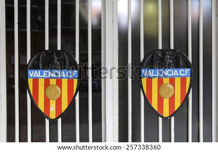 VALENCIA, SPAIN - SEPTEMBER 22, 2014: The image of the Valencia CF on gates of the Mestalla Stadium. This football stadium has a capacity for 55,000 spectators. - stock photo
