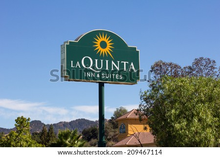 VALENICA, CA/USA - AUGUST 5, 2014: La Quinta Inn and Suites motel. La Quinta Inn is a chain of limited service hotels in the United States, Canada and Mexico. - stock photo