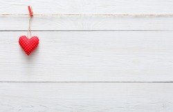 Valentine Background With Single Sewed Pillow Diy Handmade Heart On Red Clothespins At Rustic White Wood