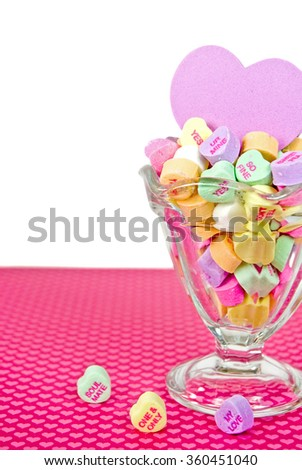 valentine candy hearts with pink foam heart in sundae glass - stock photo