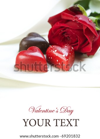 Valentine card.Chocolate hearts and red rose