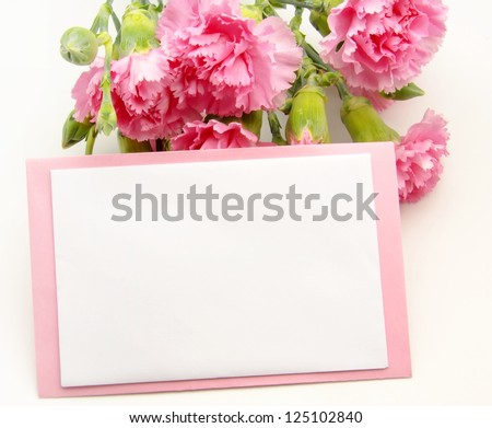 Valentine card on pink carnations - stock photo