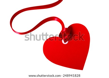 Valentine card or heart shape gift tag with red ribbon isolated on a white background. Space for copy.