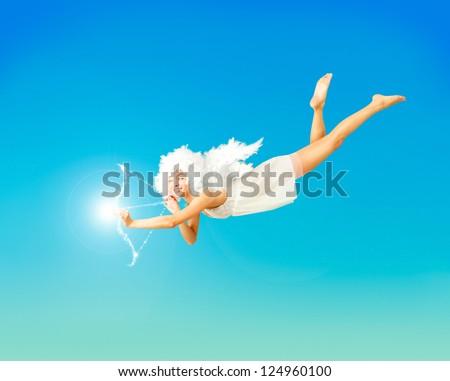 Valentine Card Vith Flying Angel on Blue - stock photo